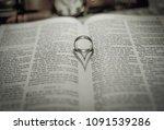 Wedding Ring  Band On Bible...