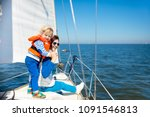mother and baby boy sail on... | Shutterstock . vector #1091546813