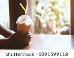 woman hand holding mango...   Shutterstock . vector #1091599118