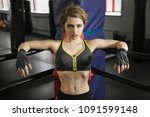 sexy boxing girl stands leaned... | Shutterstock . vector #1091599148