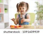 cute child little girl eating... | Shutterstock . vector #1091609939