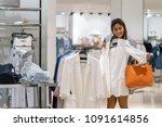 happy asian woman choosing... | Shutterstock . vector #1091614856