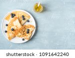 crepes with blueberries and... | Shutterstock . vector #1091642240