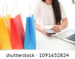 woman and small shopping cart... | Shutterstock . vector #1091652824