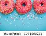 tasty donuts with sprinkles on... | Shutterstock . vector #1091653298