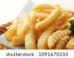 french fries crinkle cut  | Shutterstock . vector #1091670233