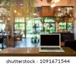 blank screen laptop on table in ...   Shutterstock . vector #1091671544