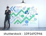 businessman using smartphone in ... | Shutterstock . vector #1091692946