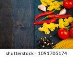 different pasta on a dark ...   Shutterstock . vector #1091705174
