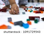 baby hand holding and picking... | Shutterstock . vector #1091729543