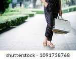 she is happily shopping at the... | Shutterstock . vector #1091738768