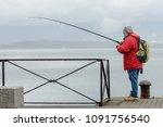man on a fishing trip on a pier   Shutterstock . vector #1091756540