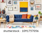 navy blue couch with bright... | Shutterstock . vector #1091757056