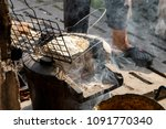the grilled dough on the grill... | Shutterstock . vector #1091770340