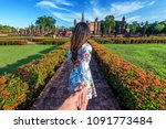 woman holding man's hand and...   Shutterstock . vector #1091773484