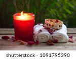 red aroma candle and towel... | Shutterstock . vector #1091795390