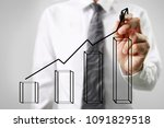 businessman drawing graphics a... | Shutterstock . vector #1091829518