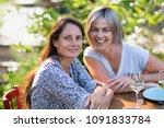 portrait of two beautiful women ... | Shutterstock . vector #1091833784