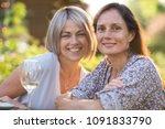 portrait of two beautiful women ... | Shutterstock . vector #1091833790