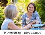 portrait of two beautiful women ... | Shutterstock . vector #1091833808