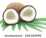Coconut with leaves closeup on a white background - stock photo