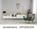 green armchair on patterned... | Shutterstock . vector #1091850104