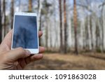 a man uses his mobile phone in... | Shutterstock . vector #1091863028