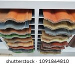 Small photo of Many color roof tiles are on shelf. Example product.