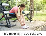 ladies are tying a shoelace.... | Shutterstock . vector #1091867240