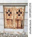 Metallic Door In A Cemetery.