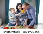 family mom  dad and son cooking ... | Shutterstock . vector #1091929556