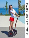 young woman riding hover board... | Shutterstock . vector #1091937704