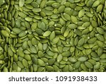 peeled pumpkin seeds | Shutterstock . vector #1091938433