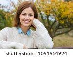 attractive happy thoughtful... | Shutterstock . vector #1091954924