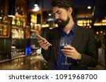 unhappy man with a glass of red ... | Shutterstock . vector #1091968700