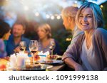group of friends gathered... | Shutterstock . vector #1091999138