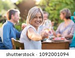 in summer. a group of friends... | Shutterstock . vector #1092001094