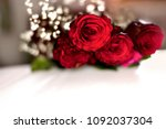 Stock photo extreme bokeh blur of bunch of red roses and small white flowers with white space also suitable for 1092037304