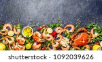 fresh raw seafood   shrimps and ... | Shutterstock . vector #1092039626