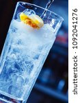 beautiful cocktail on the bar.... | Shutterstock . vector #1092041276