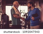 personal trainer headshake with ... | Shutterstock . vector #1092047543