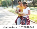 young student couple going to... | Shutterstock . vector #1092048269