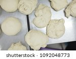 pieces of dough lying on a... | Shutterstock . vector #1092048773