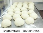 pieces of dough lying on a... | Shutterstock . vector #1092048956