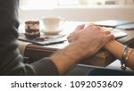 holding hands of young couple... | Shutterstock . vector #1092053609