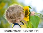 Cute Child With Sunflower On...