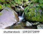 little waterfall motion blur ... | Shutterstock . vector #1092072899