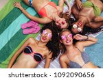 top view of happy young women...   Shutterstock . vector #1092090656
