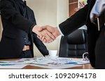 businessmen shaking hands...   Shutterstock . vector #1092094178