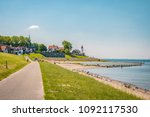 dutch dike with lighthouse and... | Shutterstock . vector #1092117530